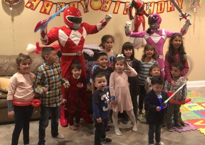 birthday-party-entertainers-for-hire-Red-and-Pink-Ranger-with-kids-min